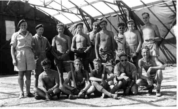 Photograph: group of men in a hanger.